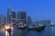 skyline and harbor of Hong Kong city at dusk