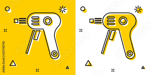 Black Electric hot glue gun icon isolated on yellow and white background Wallpaper Mural