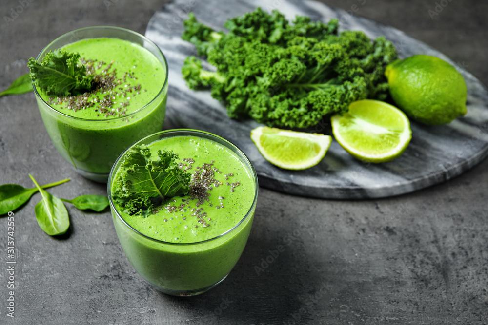 Fototapeta Tasty kale smoothie with chia seeds on grey table