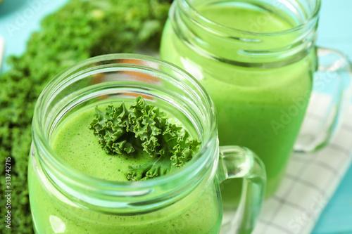 Obraz Tasty fresh kale smoothie on table, closeup - fototapety do salonu