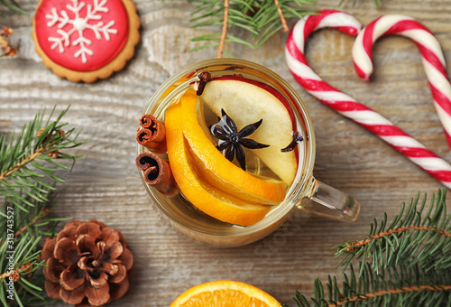 Obraz Aromatic mulled wine on wooden table, flat lay - fototapety do salonu