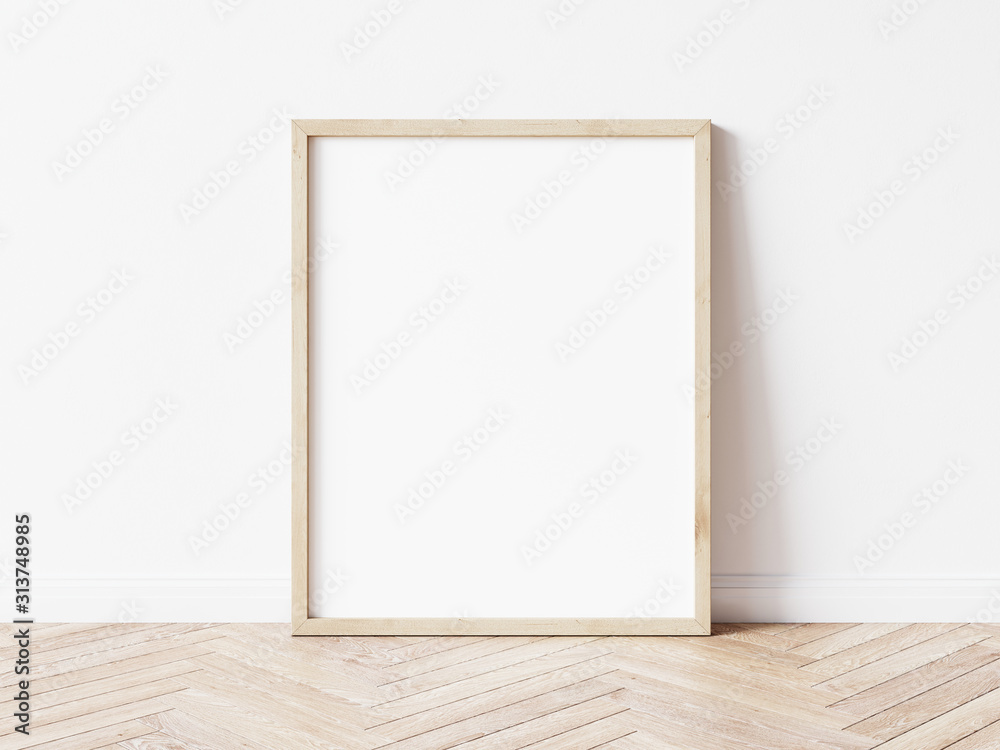 Vertical wooden frame mock up. Wooden frame poster on wooden floor with white wall. 3D illustrations.