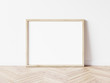 canvas print picture - Horizontall wood frame mock up. Wooden frame poster on wooden floor with white wall. Landscape frame 3d illustrations.