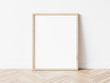 canvas print picture - Vertical wooden frame mock up. Wooden frame poster on wooden floor with white wall. 3D illustrations.