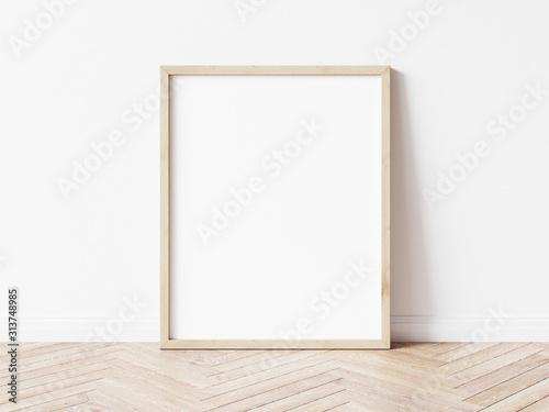 Obraz Vertical wooden frame mock up. Wooden frame poster on wooden floor with white wall. 3D illustrations. - fototapety do salonu