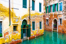 Stripping Paint On Colorful Brick Wall Architecture Buildings In Venice City Italy. Narrow Water Canal At Rear/ Back Exterior Of Old Gothic Venetian Houses/ Homes/ Hotels. Arch Doorways, Large Windows