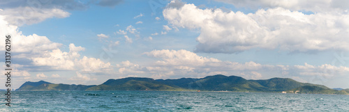Panoramic view of Ira island with white beacon and Kram Yai Island in the background. Beautiful seascape of Chonburi province, Thailand.