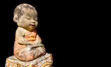 Little Buddhist Monk Statue Is...