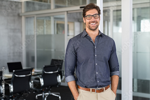 Success businessman smiling in office Fotobehang