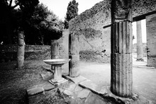 Columns And A Bird Bath Surrou...
