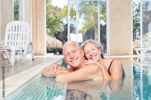 Smiling seniors couple in the swimming pool #313786345