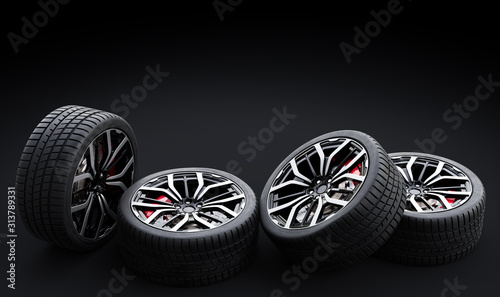 Set of wheels with modern alu rims on black background Canvas
