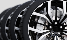 Set Of Wheels With Modern Alu Rims Close-up On White