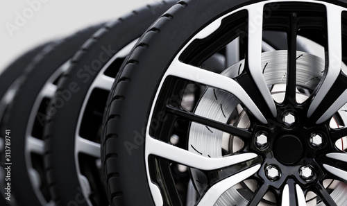 Foto Set of wheels with modern alu rims close-up on white
