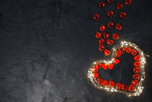 Background For Valentine's Day-heart Of A Garland With Lights And Red Hearts Inside On A Dark Background, Place For Text, Postcard For The Holiday
