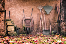 Rustic Garden Tools Against A ...
