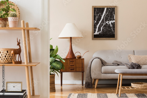 Modern composition of living room interior with brown mock up poster frame, design retro commode, sofa, bookstand, rattan basket with plant and elegant accessories. Template. Stylish home staging.