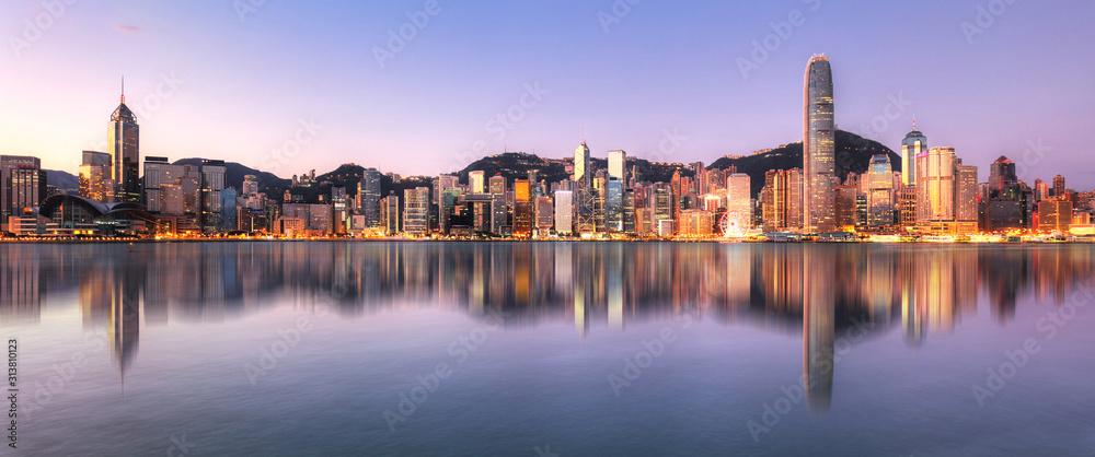 Fototapeta Hong Kong, China skyline across Victoria Harbor