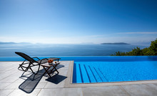 Infinity Pool With Chairs  Wit...