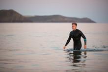 Man Wearing Wetsuit Wading Thr...