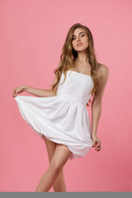 Beauty Young Woman In White Dr...