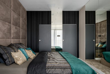 Bedroom With Mirrored And Upho...