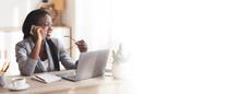 Smiling Black Female Entrepreneur Talking On Cellphone In Modern Office