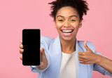 African american girl showing blank cellphone screen