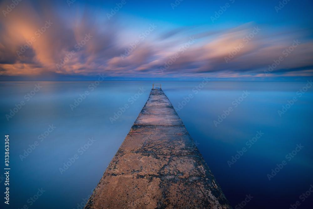 Long exposure seascape fine art photograph of pier on a sunrise in Paphos, Cyprus