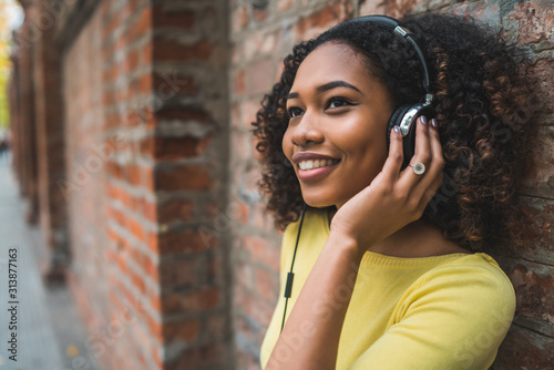 Afro american woman listening music - 313877163