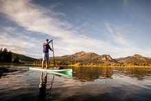 One Woman Paddle Boarding On L...