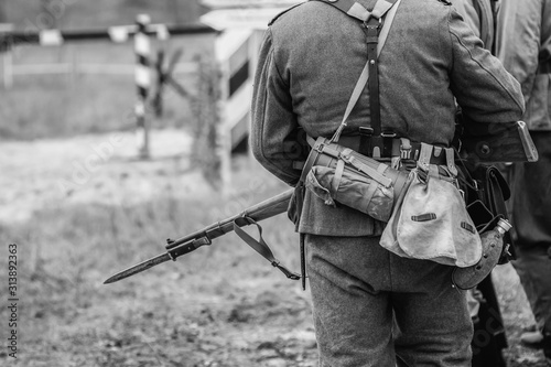 Obraz na plátně German soldier during the second world war in uniform with a rifle and bayonet with a knife