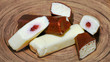 Kohuke chocolate covered cheese curds make sweet Estonian energy bars or cake. Filled with jam and soft sweet whipped curd.