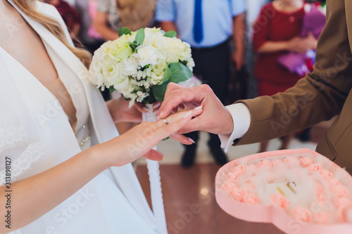 newlyweds append signatures in a registry office during wedding registration Wallpaper Mural