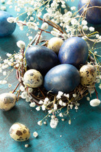 Blue Easter Eggs In A Nest On ...