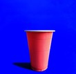 canvas print picture - Red glass on blue background. beer pong game. party concept