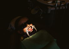 Boy Under Lamp With Teeth Ready For Braces In Clinic