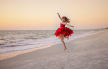 Young Girl Dancing And Twirlin...