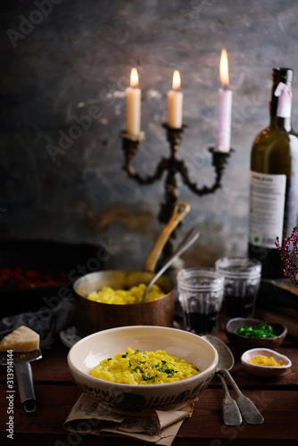 Photo  Milanese risottoon the table...style rustic.