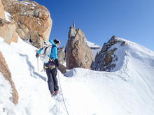 Woman Alpinist Looks Over Shou...