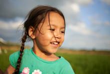 Headshot Of A Cute Young Asian...
