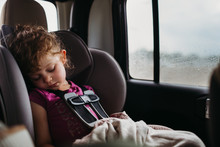 Young Girl Sleeping In Car Sea...