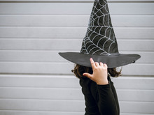 Side View Of Girl Wearing Witch's Hat