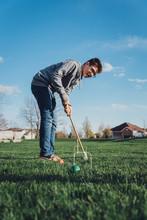 Teen Boy Playing Croquet Outsi...