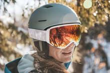 Woman In Ski Goggles And Helme...