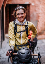 Female Cyclist Stands For A Po...