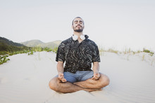 Man Meditating In A Nature Bea...