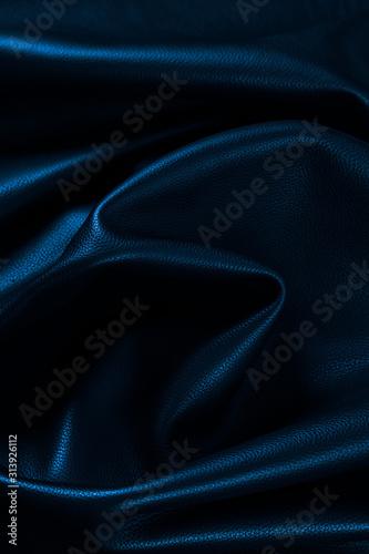 Photo Texture cuir bleu marine noir plissé