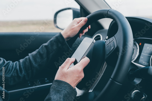 Fototapeta Texting and driving is dangerous behavior in traffic