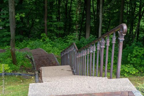 Fotografía Stairways with stone railings balusters and iron lanterns, landscape design walk